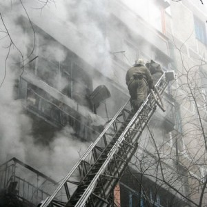 Help with Fire Safety Actions-Fireman on Ladder with Burning Building